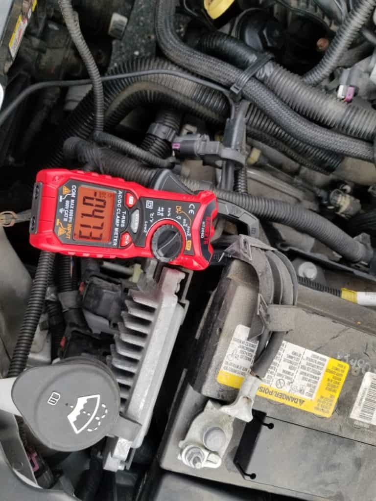 reading amps from car battery while playing radio